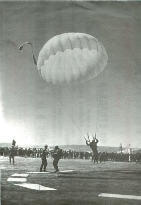 French airborne soldiers demonstrate accurate parachute drops.