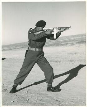 Airborne REME officer demonstrating firing positions, Jordan