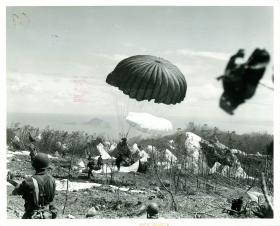 Parachutists of the 503rd Parachute Regiment landing on B field, February 1945.