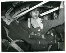Men of the US 504th Parachute Battalion get ready to exit the aircraft, 1942.