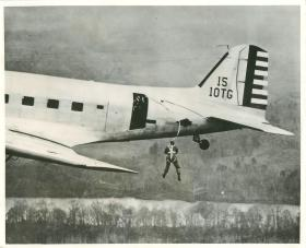 US paratrooper having just exited the aircraft.