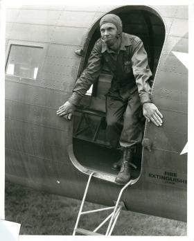 Paratrooper of 501st Parachute Battalion exits plane after inspection.