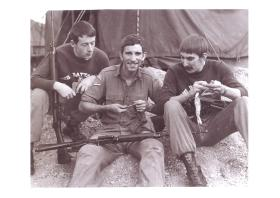 Corporal Stephen Prior (right) and comrades clean their rifles.