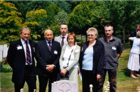 Members of Corporal Stephen Prior's family at his gravestone.