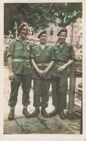 Private Bingham in Far East with two soldiers, c1945.
