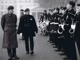 Capt Pike and BM Wroe walk past band, 1 PARA public duties, 1969