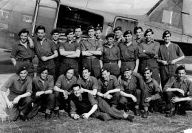 Victor Cox by a Dakota with fellow Paras, circa 1945-46.