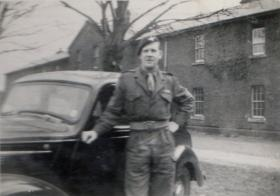 Taylor stands beside car whilst with D Coy, 11th Parachute Battalion, 1955