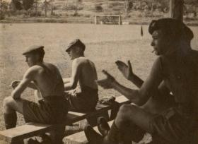 Taylor watching game of football in Semerang, Java, 1946