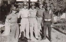 Pte Kimber with colleagues having just swapped headdress with Arab league, circa 1946