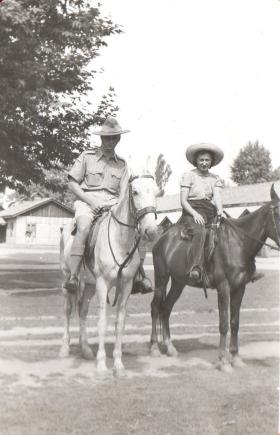 Lt Bolton and lady on horse back, circa 1943