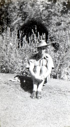 Lt Bolton in uniform sitting in garden, Srinagar Kashmir, circa 1942