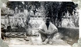 Lt Bolton sitting in garden in Srinagar Kashmir, circa 1942