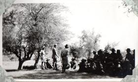 Men of 152 (Indian) Parachute Battalion receive briefing under tree, circa 1943