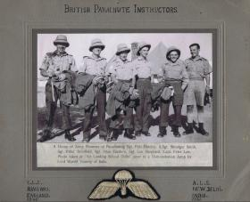Parachute jumping instructors recently arrived from Ringway in tropical helmets that were soon disregarded by all troops.