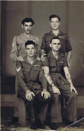Sgt McCormick with friends in Kuala Lumpar, 1946