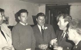 McCloskey listens to conversation at Arnhem Reunion