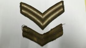 Cpl Holtom's stripes.