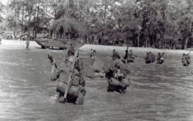 Members of 12 Para Bn landing at Morib Beach, Malaysia, September 1945.