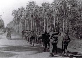 Members of the 12th Para Bn march off having landed at Morib Beach, Malaya, September 1945.