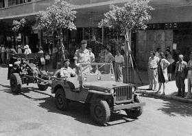Airborne jeep of 87 Airborne Field Regt on King's Birthday Parade on Kingsway, Haifa, Palestine, 1947