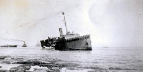 SS. Vlua beached off foreshore at Peninsular Barracks Bat Galim, Haifa. 28th Feb 1947.