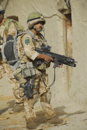 Soldier from 3 PARA pauses on patrol, Musa Quelah, Afghanistan, 2008