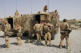 Members of 3 PARA with a Mastiff patrol Vehicle, Musa Qala, Afghanistan, 2008.