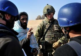 Lieutenant Colonel James Coates, CO 3 PARA, talks with locals, Afghanistan, 2011