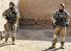 Soldiers from 3 PARA pause whilst on foot patrol, Afghanistan, 2011
