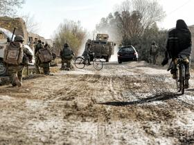 Soldiers from 3 PARA patrol through the busy town of Naqilabad Kalay, Afghanistan, 2011