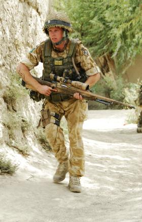 3 PARA sniper moving forward to a new firing position, Afghanistan, 2008