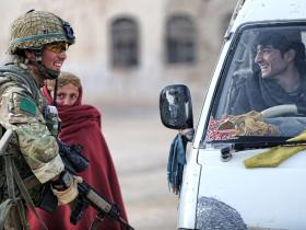 A soldier from 3 PARA talks to a young motorist in Naqilabad Kalay, Afghanistan, 2011