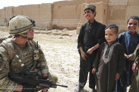 A Soldier from A COY,  3 PARA Talking with Local Children, Showal, Afghanistan, 2011