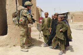 A soldier from A COY, 3 PARA, Talks with Local Children, Showal, Afghanistan, 2011