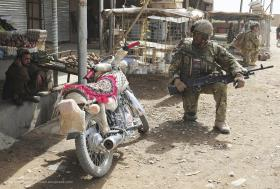 A Soldier from A COY, 3 PARA, Talks with a Local, Showal, Afghanistan, 2011