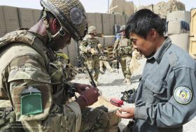 A Soldier from A COY, 3 PARA, Provides First Aid to an Afghan Policeman, Showal, Afghanistan, 2011