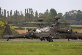 Two Apaches of 4 Regt AAC hover taxi on training sortie, Wattisham, Oct 2010