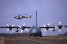 4 Regt AAC Lynx covers the landing of a C130 on exercise
