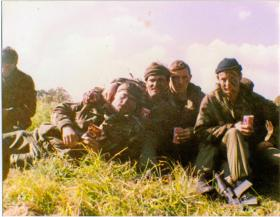 Pte's Crichton, Ellis, Joliffe and Dunne enjoy a sunny day on exercise in Otterburn, Northumberland, 1980s