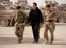 Prime Minister David Cameron accompanied by Chief of Defence Staff and CO 2 PARA, Afghanistan, December 2010