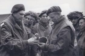 Members of the 6th Airborne Divisional Signals with a pigeon, prior to D-Day, 5 June 1944.