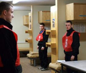 Potential recruits stand by their beds ready for block inspection.