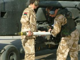 Ground crew from 654 Squadron AAC reload a CRV 7 Rocket Pod for a strike during Op Herrick 9, Afghanistan, 2008