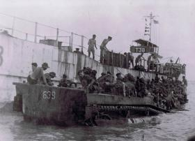 12th Para Bn board landing craft at Port Dickson, Malaya, August 1945.