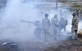 Airborne gunners take part in a direct fire mission using a 105mm Light Gun, Exercise Eagles Resolve 12, Warcop, 2012.