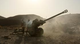 Soldiers with 7 Parachute Regiment Royal Horse Artillery fire their 105mm Light Gun at Taliban positions, Afghanistan, 2008.
