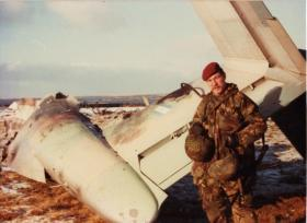 'Yank' Thayer standing next to Argentinian Pucara A-527 at Goose Green, blown apart by a Cluster Bomb Unit (CBU)