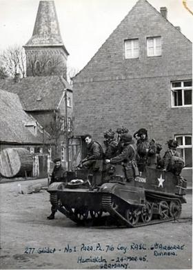 Troops of 1 Parachute Pl, 716 Light Comp Coy RASC aboard a Universal Carrier, Hamminkeln, March 1945.