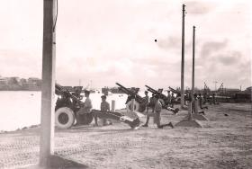 Members of C Troop firing the royal salute on the Queen's Birthday, Aden 1957